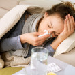 Foto de Stock  : Sick Woman. Flu. WomCaught Cold. Sneezing into Tissue