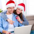 Christmas Online Shopping. Couple Using Credit Card to E-Shop  — Zdjęcie stockowe