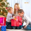 Happy Children with Christmas gifts  — Photo