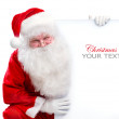 Santa Claus holding Banner with Space for Your Text — Stock Photo #16276173