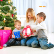 Happy Children with Christmas gifts — Stock fotografie #16276195