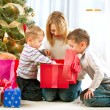 Happy Children with Christmas gifts — Stock fotografie #16276233