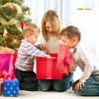 图库照片: Happy Children with Christmas gifts