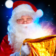Christmas Santa. Santa Claus opening Magic Bag with Gifts — Stock Photo