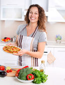 Happy Young Woman Cooking Pizza at Home — Stock Photo