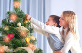 Kids Decorating Christmas Tree. Happy Children — Stock Photo