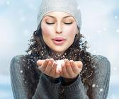 Christmas Girl. Winter woman Blowing Snow — Stock Photo