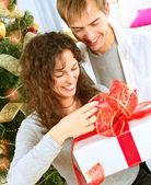 Happy Couple Opening Christmas Gift. Christmas Family — Stock Photo