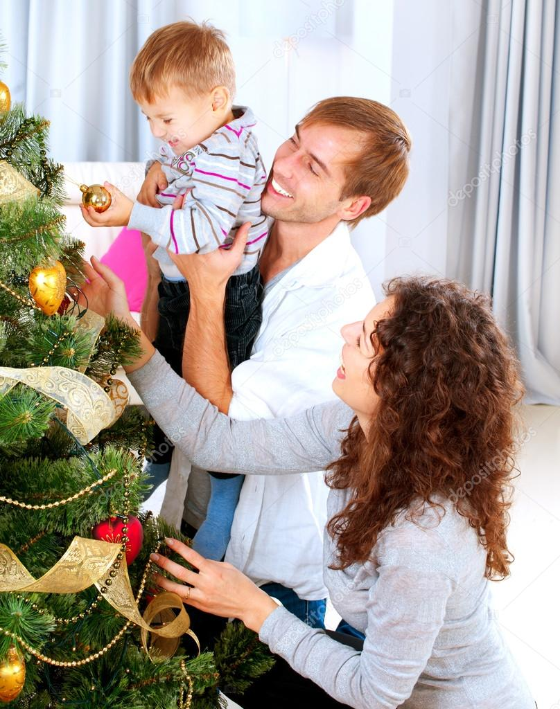 Happy Family Decorating Christmas Tree Together Stock