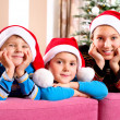 Stock Photo: Christmas Children. Happy Little Kids wearing Santa's Hat