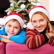 Stock Photo: Christmas Children. Happy Kids wearing Santa's Hat
