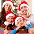 Photo: Christmas Family with Kids. Happy Smiling Parents and Children
