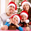 Christmas Family with Kids. Happy Smiling Parents and Children — 图库照片 #19735019