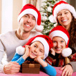 Christmas Family with Kids. Happy Smiling Parents and Children - Stok fotoraf