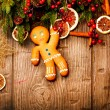 Christmas Holiday Background. Gingerbread Man over Wood — Stock Photo #19736919