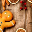 Stock Photo: Christmas Holiday Background. Gingerbread Man over Wood
