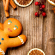 Christmas Holiday Background. Gingerbread Man over Wood — Stock Photo #19737627