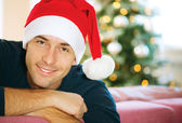 Handsome Young Man wearing Santa's Hat. Christmas Guy Portrait — Stock Photo