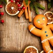 Christmas Holiday Background. Gingerbread Man over Wood — Stock Photo #19742943