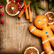 Christmas Holiday Background. Gingerbread Man over Wood - Stock Photo