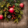 Photo: Christmas Decoration. Holiday Decorations over wooden background