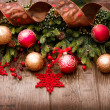 Stock Photo: Christmas Over Wooden Background. Decorations over Wood