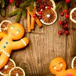 Christmas Holiday Background. Gingerbread Man over Wood — Stock Photo #19745503