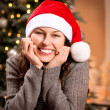 Christmas Woman in Santa Hat. Happy Smiling Girl - Stock fotografie