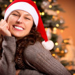 Christmas Woman in Santa Hat. Happy Smiling Girl — Stock Photo #19746643