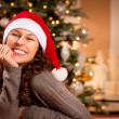 Christmas Woman in Santa Hat. Happy Smiling Girl — Stock Photo