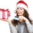 Christmas. Happy Smiling Woman with Gift Box and Credit Card  — Zdjęcie stockowe