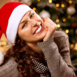 Christmas Woman in Santa Hat. Happy Smiling Girl  — Photo