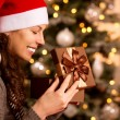 Christmas. Happy Surprised Woman opening Gift box  — Стоковая фотография