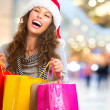 Christmas Shopping. Woman with Bags in Shopping Mall. Sales — Stock Photo