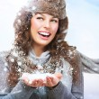 Christmas Girl. Winter woman Blowing Snow — Stock Photo #19747819