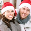 Stock Photo: Christmas Couple wearing Santa's Hat