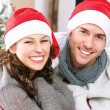 Foto de Stock  : Christmas Couple wearing Santa's Hat
