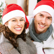 Stock fotografie: Christmas Couple wearing Santa's Hat