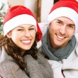 Christmas Couple wearing Santa's Hat  — Stock Photo
