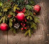Christmas Decoration. Holiday Decorations over wooden background — Stock Photo