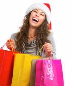 Compras de navidad. mujer con bolsas sobre blanco. ventas — Foto de Stock