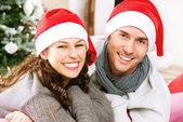 Christmas Couple wearing Santa's Hat — Stock Photo