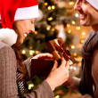 Christmas Scene. Happy Couple with Christmas Gift at Home  — Stock Photo