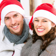 Stok fotoğraf: Christmas Couple wearing Santa's Hat
