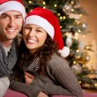 Christmas. Happy Couple at home celebrating Christmas - Foto Stock