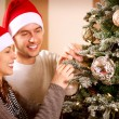 Happy Couple Decorating Christmas Tree in their Home — 图库照片