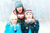 Family Outdoors. Happy Family Blowing Snow — Stock Photo