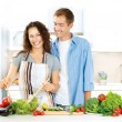 Happy Couple Cooking Together. Dieting. Healthy Food - Stock Photo