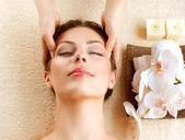 Spa Massage. Young Woman Getting Facial Massage — Stock Photo