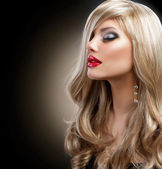 Beautiful Blond Woman with Holiday Makeup over Black — 图库照片